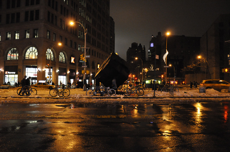 1/1/11 Daily Photo.<br /> <br /> East 8th & Lafayette Streets, East Village, New York City.<br /> <br /> I like the light, the bikes, the cube, the melting snow.