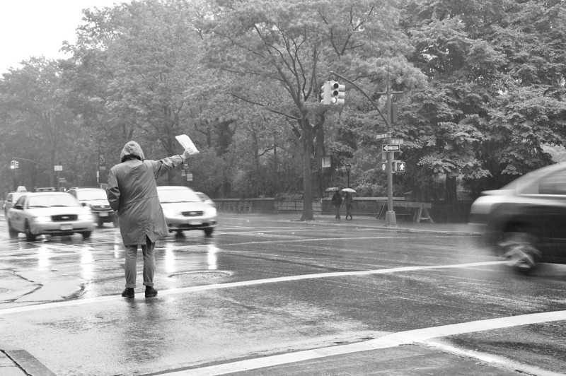 "September 12, 2010.<br /> <br /> Hailing a cab in the rain.<br /> <br /> And no, he did not get one. At least not while I was there.<br /> <br /> Here's a link to some more Sunday in the rain pics:    <a href=""http://inourtime.smugmug.com/Photography/Rainy-Sunday/Sunday-in-the-Rain/13744993_KNDg5#1005256822_4Q8yN"">http://inourtime.smugmug.com/Photography/Rainy-Sunday/Sunday-in-the-Rain/13744993_KNDg5#1005256822_4Q8yN</a>"