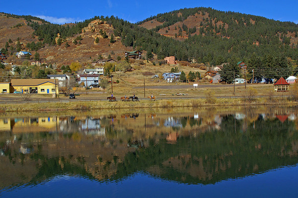 11-08-10: A companion piece to my shot yesterday. After the train rolled through a quartet of horseback riders passed by the reflective Palmer Lake.