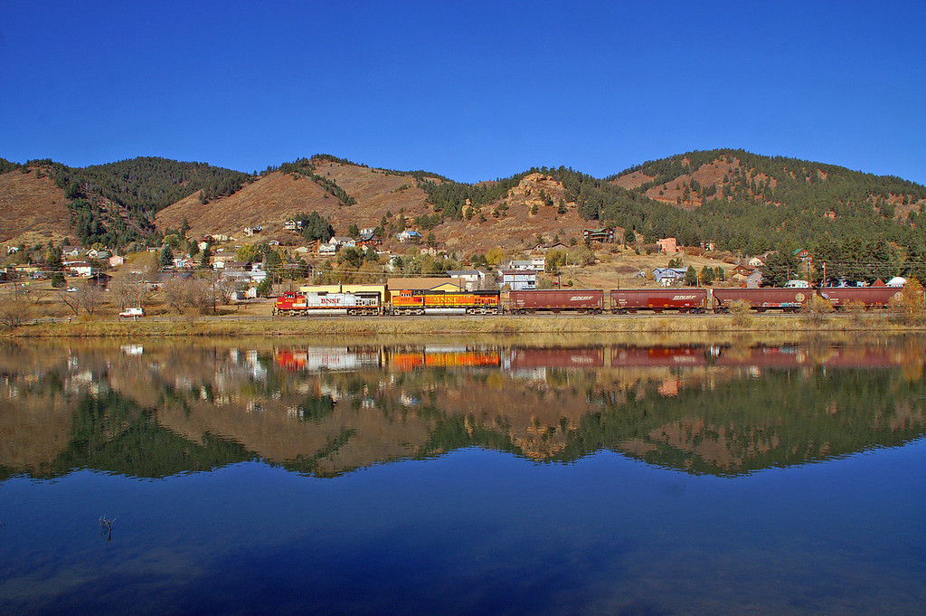 11-07-10: A BNSF grain train makes a great reflection in the waters of Palmer Lake on a truly spendid November Saturday.