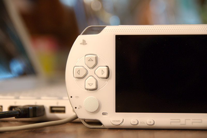 My daughter's white PSP (OK, we share it) arrived on July 21, 2006. Her MacBook is in the background.