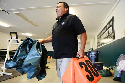 Joe Guyeska prepares to set up for Friday's football game at Elyria Catholic High School. KRISTIN BAUER | CHRONICLE