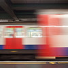 Slowish exposure (1/8 second), of 2 tube trains arriving at the station at the same time, note the slight transparency of the one on the right.