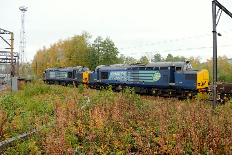 37608 and 37259 waiting to join the mainline out of Crewe Coal Sidings. 28/10/15.