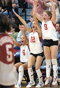 jhcavb2 - Emily Cutting (6), Emily Rivet (12) and Carolyn Rositano (9) react as Canandaigua scored the winning point over Wayne on Saturday.