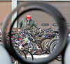 jhauction1A - Looking through drainage pipes on the grounds, Bob Barrett of Avon inspects some of the bicycles that were auctioned off on Wednesday 12/14 at the City of Canandaigua impound yard on Saltonstall St.