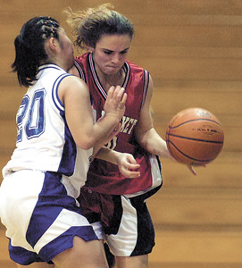 jhbloom/rjgb1 - Red Jacket's Jessica Buttaccio and Bloomfield's Tara Vaiana (20) collide near the sideline in the fourth quarter. No foul on the play as Buttaccio was called for being out of bounds.