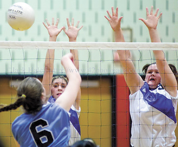 jhbloom/ganvb2 - Bloomfield's Tabatha Chastang (left) gets a piece of the ball as teammate Jody Hammond joins her in a block attempt against Gananda's  Catherine Rieck in game one.