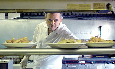 jhcassidy1 - John Rozaklis, owner of Cassidy's on Rte 96 in Farmington puts up some lunch orders on Wednesday 2/25. He feels the improved Finger Lakes Gaming and Racetrack as improved his business.