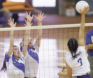 jhbloomvb3 - Bloomfield's Michelle Claus and Cori Hept go up to block a shot from Chelsey Cummings of Chautauqua Lake.