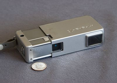 Minolta 16.  This camera used 16mm film packaged in a dedicated cartridge.  The film and cartridges haven't been made since 1990.