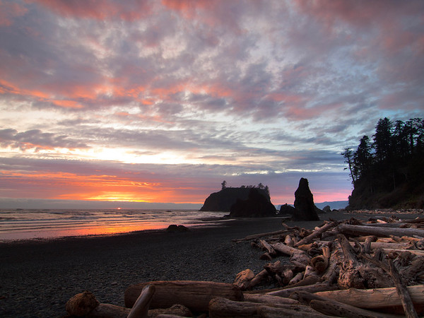 "<center><b>Sunset at Ruby Beach - Olympic National Park</b></center><br>On the drive back from the Hoh Rain Forest, we stopped and waited for the sunset at Ruby Beach. This location has some of the classic ""haystack"" formations off the shore and a nice tumble of old logs washed up on the beach. The sunset that night was particularly nice with just enough clouds to provide some wonderful color."