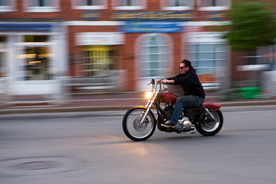 "Week 3: Shutter Priority: Panning: ""Live Free or Die.""  Shot in the early evening dusk.  Shot at 70mm at 1/25s using the Nikkor 24-70mm lens mounted on the D700."