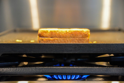 Grilled Cheese Sandwich on a gas stove