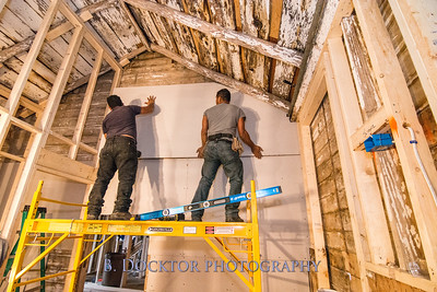 Installing sheetrock in Ghent NY barn renovation