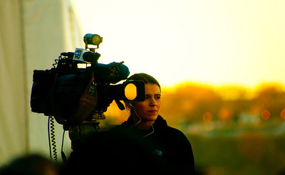 Camera girl for NY1 at Veteran's Day on the USS Intrepid.