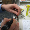 Day 73<br /> <br /> Pin-out Pin-out lovely lovely Pin..Outs ..<br /> <br /> well no, those aren't my hands doing the soldering .. it wouldn't be my photo otherwise. Still this day was mostly about cable, and annoying plugs .. <br /> <br /> Gotta love the old school stuff though (this cable was for an optical workstation, the thing an optometrist measures your eyesight with, to computer serial link).