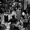 Day 26<br /> <br /> A busy lunchtime crowd in the Strand arcade. Photo was actually taken on my little dody phonecam - but I like the grungy nature of it.  I love the people trying to look away .. granted I'd do the same.<br /> <br /> B&W FTW!.