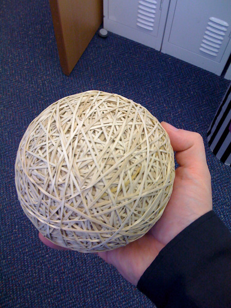 "Day 99 <br /> <br /> That's a whole lot of rubber! They have this massive rubber band ball at our Blacktown branch, it has even got a name ""Boom"". Apparently it has grown over several years and even outlasted the managers at that branch. Hello Boom."