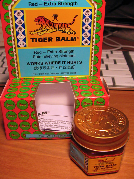"Day 35<br /> <br /> Red Tiger Balm - contains Cassia Oil and less Mint Oil than the white version - though i much prefer the white one (I didn't pay attention when I bought it).<br /> <br /> This is supposed to tbe the Extra Strength version .. not sure .. all I can say is .. I just played tennis for two and a half hours and for some reason my calves feel like they have had a small German army march across them., not to mention my joins which .. well.. don't... much.<br /> <br /> Anyway .. ""Works Where It Hurts"" it says on the box - I wonder if they make this as shower gel because I could use some of that ""all over"" treatment."