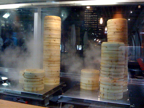 """Day 96<br /> <br /> Dinner at Din Tai Fung - a large chain of dumpling restaurants. (by large I mean like ~30 places across around nine countries large). Not bad food - a little expensive but not bad.<br /> <br /> Those """"hotplates"""" are covers with 4 steam holes in them (about 1-2cm diameter) - nifty!<br /> <br /> BTW: just checked the geocoding feature on SM - nearly there but not quiet - probably had to rely on cell phone tower triangulation so it's accurate to about 20m or so."""