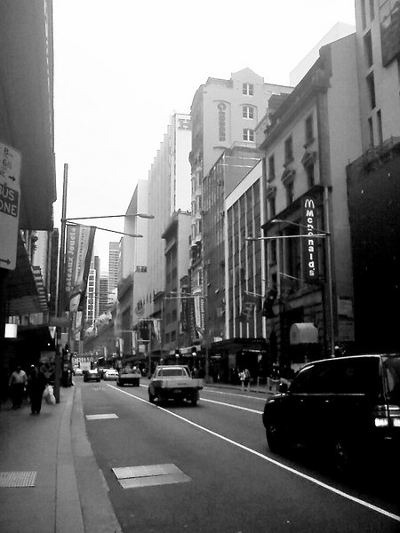 Day 39<br /> <br /> I am really shooting from the bottom of the barrel here. I shot this photo on Sydney's George street (Just opposite of what will be the new Sydney Apple Mac store). Pointing my old phone cam southward. <br /> <br /> I wasn't much of a shot - though In B&W it somehow makes the city a little bit more dirty, grimey, which on an overcast day, surrounded by building sites, it well, was. <br /> <br /> Oh this was photo #100 on my phonecam .. woohooo. Now if I could just get them to upgrade the optics (yeah, it's blown out =) -  the original image was a bit flat and boring =))