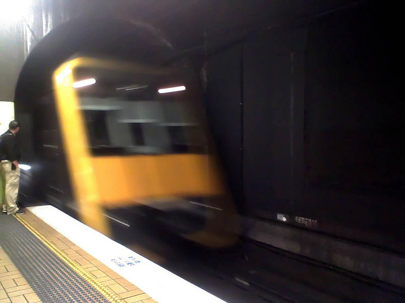 Day 48 (a)<br /> <br /> Returning home from the city after seeing Ironman (not bad actually) - couldn't be bothered walking from town hall to wynyard busses .. (yes overcome by lazyness - I apologise). <br /> <br /> This is the incoming train at Town Hall station.
