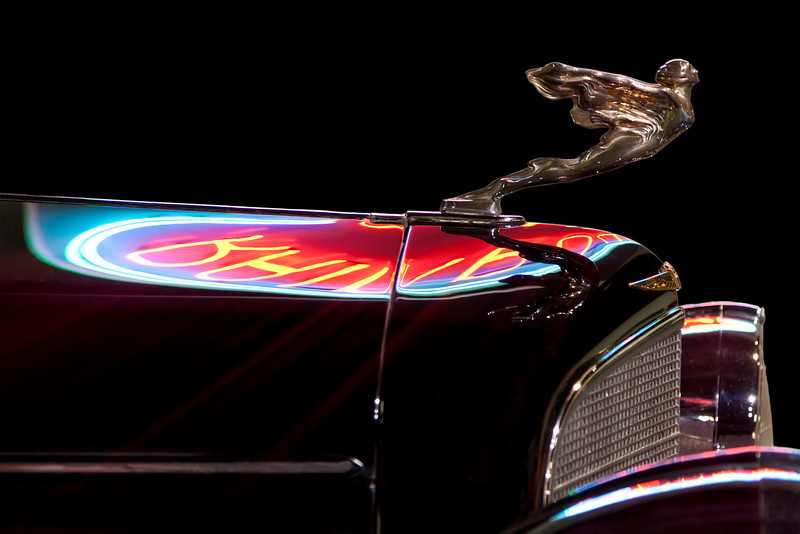 Vintage Automobile with neon sign reflection