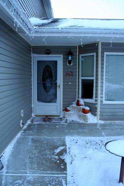This is the first time we ever had snow up to our front door.  As you can see we had our Thanksgiving decorations out and got snow on the pumpkings.