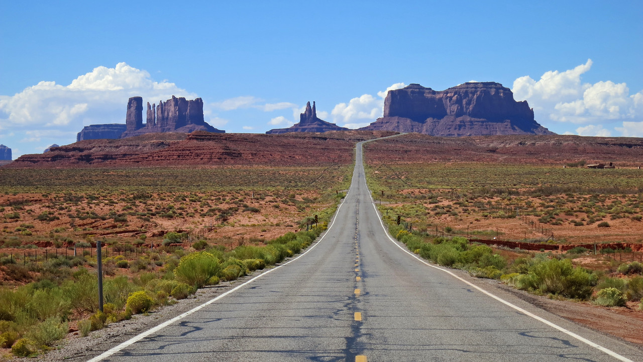 Just before entering Monument Valley from the north you get this classic view of the long straightaway leading to it.  The valley lies just beyond the buttes in the distance.