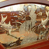 Hand-crafted artwork etched into a glass panel.