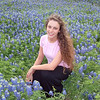 Two signs you're in Texas -- a gorgeous lady and a field of beautiful Bluebonnets.