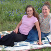 Kimberly with her mom, sitting on a quilt that Sandy made for her.