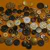 Sandy has a peculiar fascination with buttons. She has about a ga-zillion buttons of every shape, size and color. This is only a fraction of some of the more ornamental buttons in her collecton.