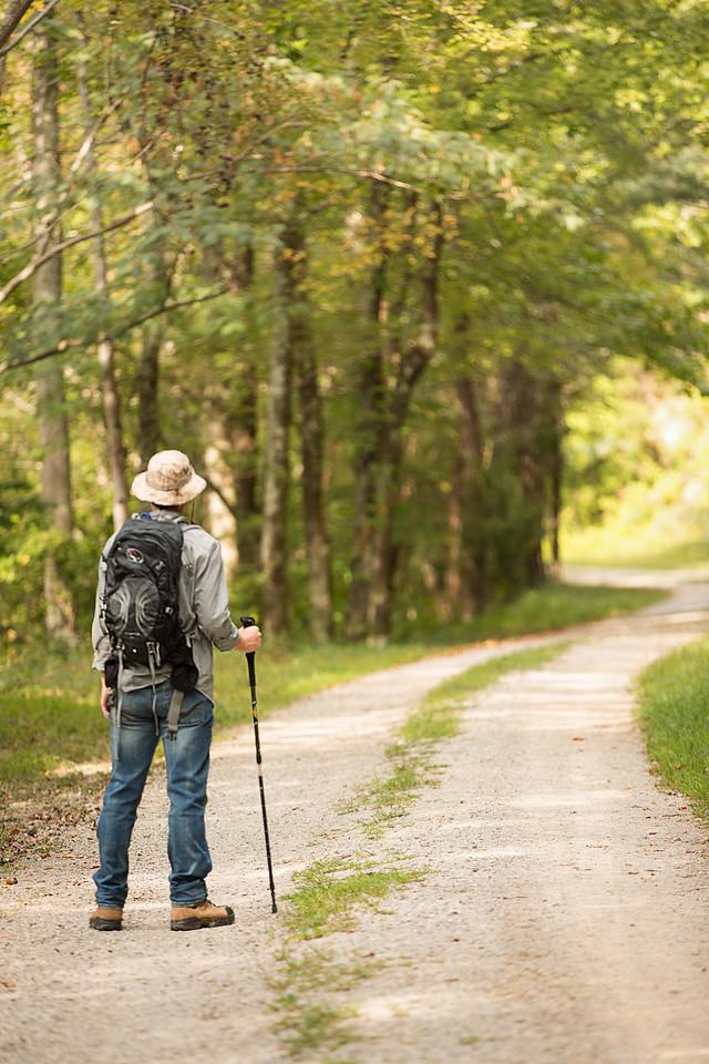 Senior boy on path, walking stick