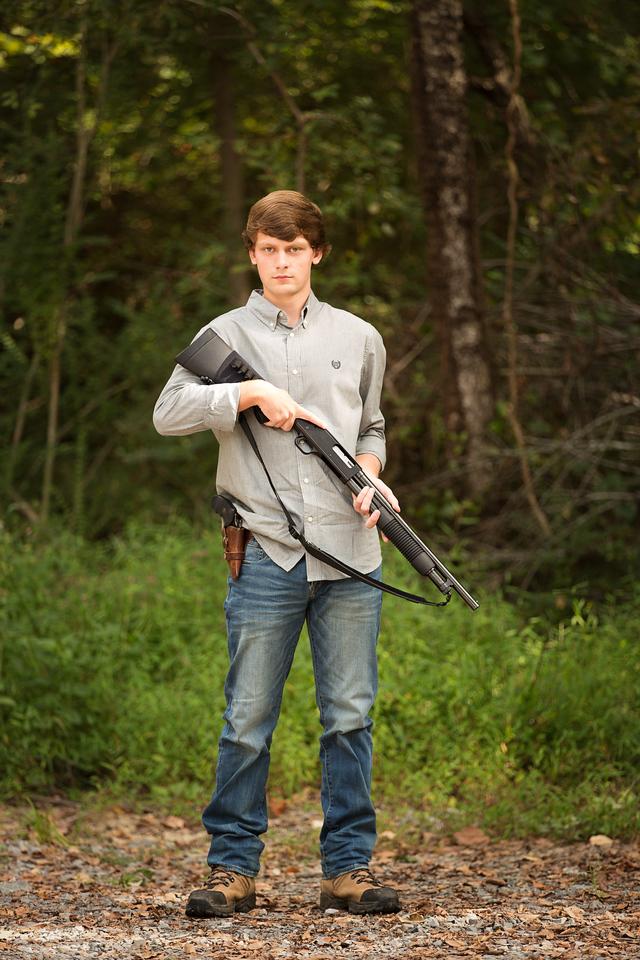 Senior boy with hunting gun