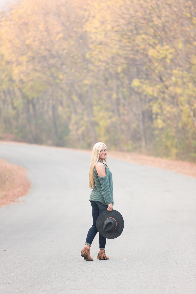 Senior girl on road with hat Chattanooga Senior Pictures