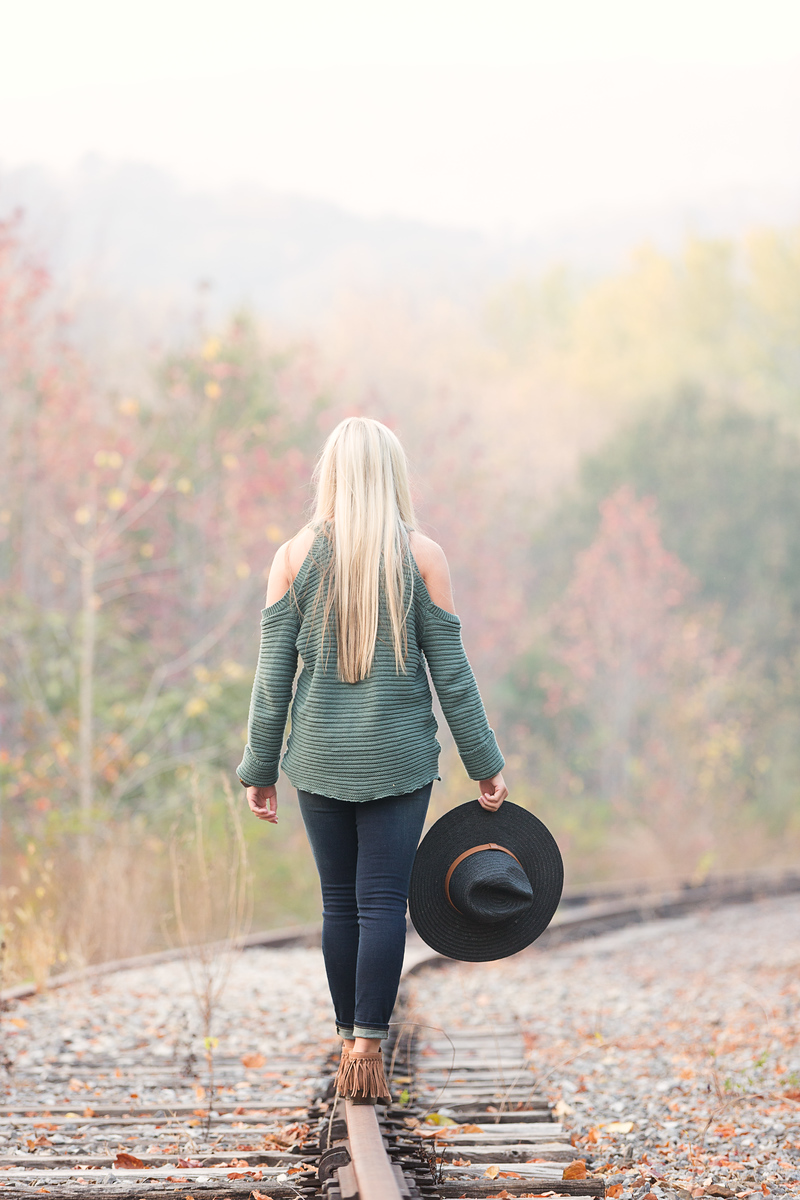 Senior girl with hat on railroad tracks Chattanooga Senior Portraits
