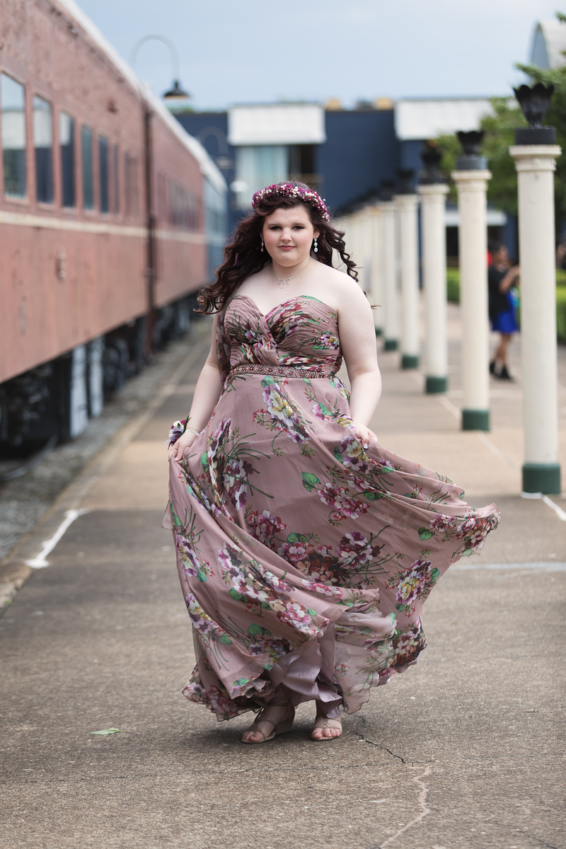 Girl by the trains in prom dress at Chattanooga Choo Choo