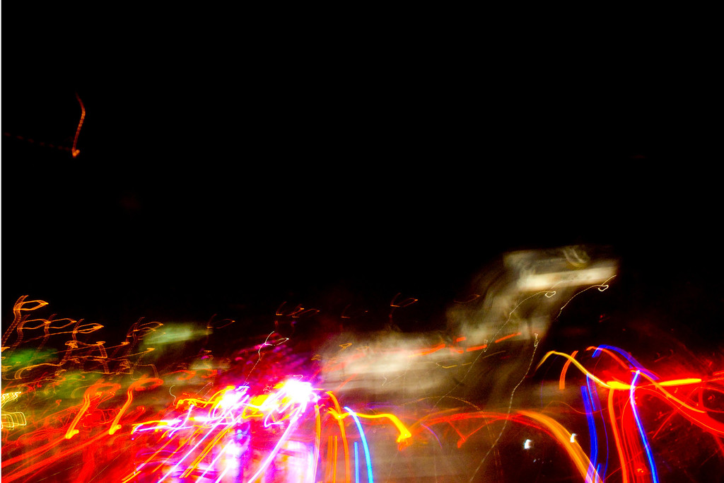 December 1rst, 1rst offical day of my Photo A Day Journey, Lights on the freeway, downtown Dallas. 8:00pm...yes I was driving and shooting....