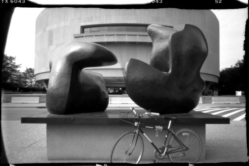 "Hirshhorn Museum and Sculpture Garden, my bike and ""Two Piece Reclining Figure: Points in Washington, DC"", by Henry Moore."