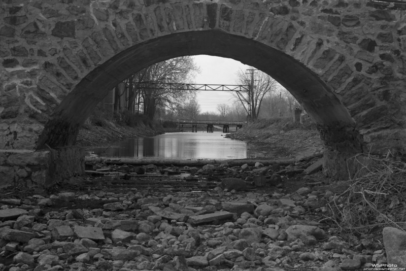 Empty Millrace 1<br /> <br /> Crawled down into the millrace while they had it emptied for construction of a pedestrian underpass. Thought black & white best reflected the mood of this shot.