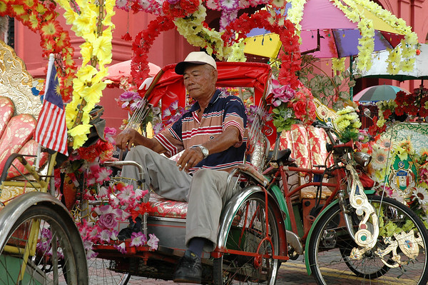 Rickshaw driver - Malacca, Malaysia