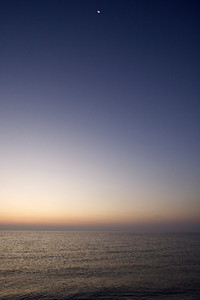 Moon over sunrise - Persian Gulf
