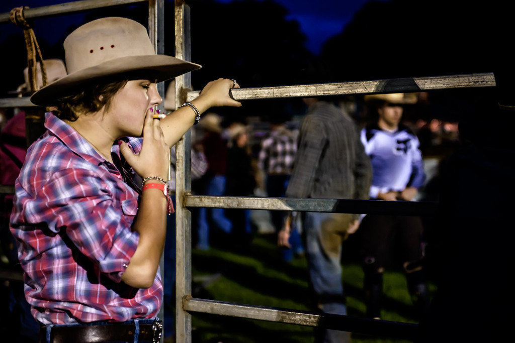 A rodeo rider has a last cigarette before riding a bull.