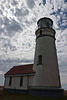Cape Blanco lighthouse reaches for the clouds - Oregon Coast.<br /> Photo © Carl Clark