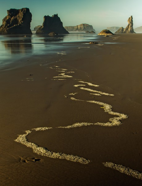 Sea foam leads your eye to incredible rock formations at Bandon, Oregon.<br />  Photo © Cindy Clark