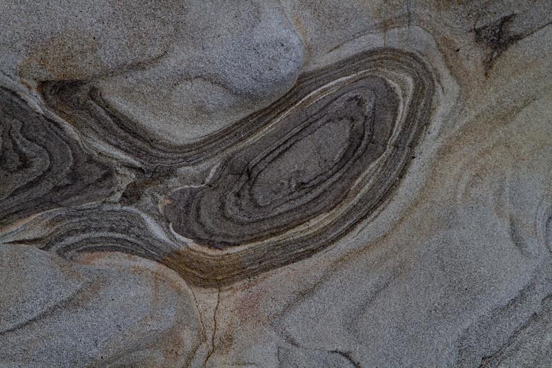 Sandstone art at Cape Arago, Oregon.<br /> Photo © Carl Clark