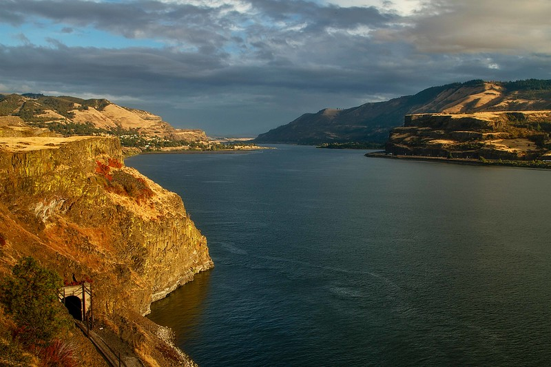Autumn light brightens the cliffs along the Columbia River west of Lyle, Washington.<br /> Photo © Carl Clark