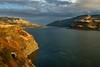 Autumn light brightens the cliffs along the Columbia River west of Lyle, Washington.<br /> Photo © Carl Clark